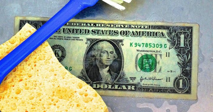 Dish sponge and USA dollar note signifying money laundering