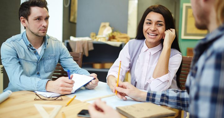 A group of three people interacting signifying the soft skills referred to in the article