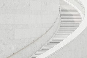A simple white staircase signifying lean change