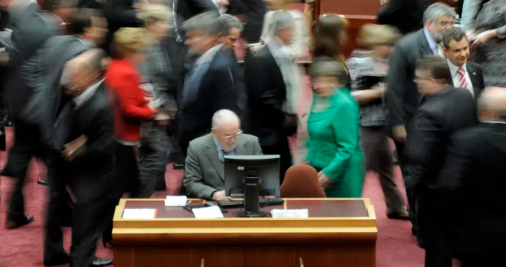 Image of Australian Senators crossing the floor for an energy vote